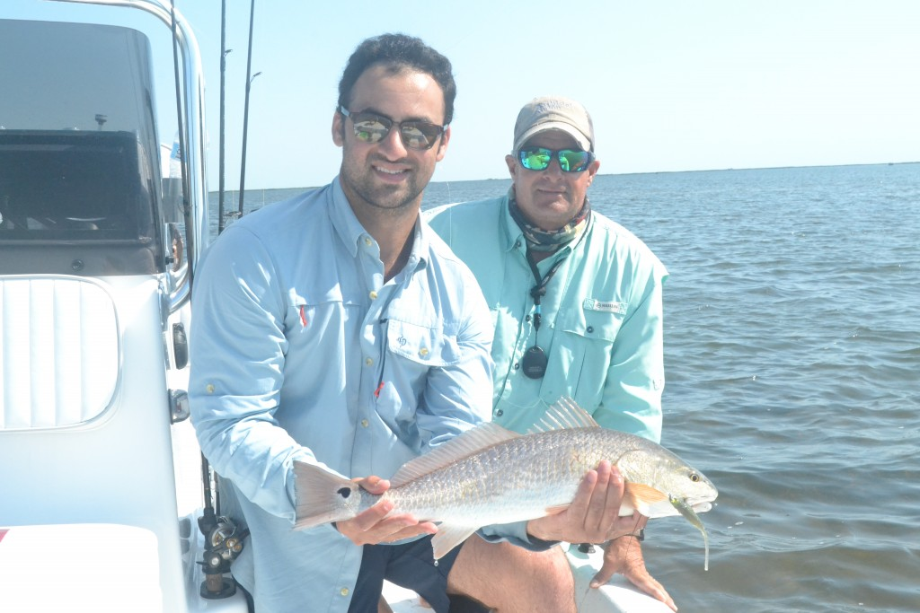 captain experiences jonathan newar holding redfish in aransas pass with captain Larry B