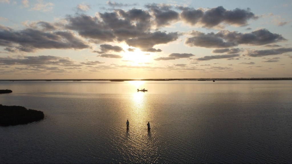two people casting just after sunrise in Aransas Pass, TX
