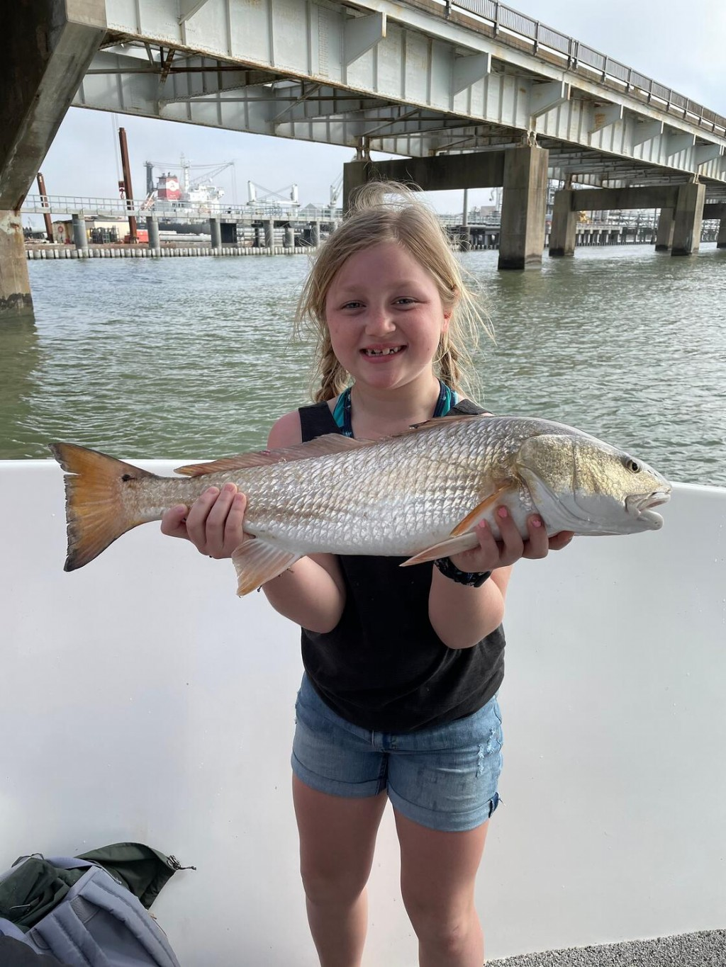 Little girl with redfish
